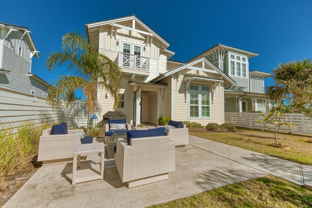 BREEZY COASTAL UPSCALE HOME, JUST WAITING FOR OWNERS TO ENJOY THE VIEWS! This upscale gated community is the desired place for selective owners. Expansive water views just steps away from the covered back porch. This 2-story coastal home is a 3b/3b/2car + family room. And boasts 2647 sq. ft. giving it a breezy spacious feeling. Custom finishes throughout is what buyers love about this home. Oversized premium lot with a fenced private courtyard, lush landscaping & firepit. Bayfront views from your living, kitchen & master bedroom. Upgraded appliances (Wolf Range) with fryer! Fireplace w/shiplap & Shiplap accent wall -dining. Large upper deck overlooking bayside waters with a hanging bed! Elevator ready, oversized master shower with multi sprayers & rain head. You wont find a better priced home with all of these handpicked features! Reserve offers high-end resort amenities: resort pool w/cabanas, Hammock Park w/grills, firepits, stage. Mile long lighted boardwalk w/400 ft pier