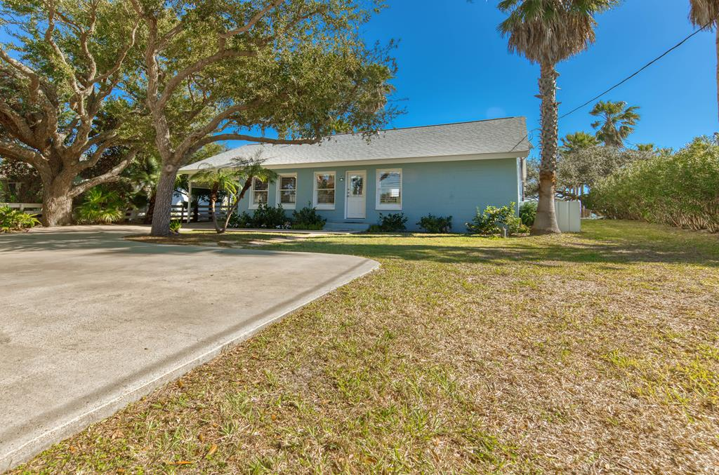 Unique, impeccable & rarely offered. 520 S Fulton Beach Road is a spectacular beachfront beauty with East Coast elegance. Shaded & secluded by sweeping Live Oaks there's plenty of off street parking for a small crowd. White plantation shutters & a soft blue hue bring a coastal feel upon entry. Once inside, grab a cocktail at the wet bar & take time to gaze upon the panoramic Aransas Bay views. Generous granite counters, island kitchen with breakfast bar create the perfect place to prepare fresh seafood. Each guest bedroom boasting a private bathroom and privacy, don't forget the separate guest quarters just to North of the carport. Gently wake to filtered sunlight through the master bedroom with beach views. Relaxing with friends is easy in this open and airy living room or under the expansive and covered back patio. Over half an acre of grassed lawn for croquet or take the kayaks for a paddle. End the night listening to gentle waves wash upon your private beach relaxed & content.