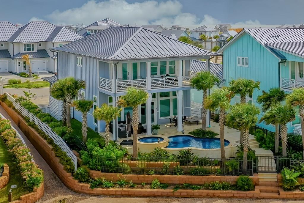 RARE FIND ON BAYSIDE! HOME W/ POOL. You will love living in this upscale high-end community. Upon entering this beautiful 4b/3b custom home, your eyes are drawn to the wall-to-wall windows overlooking the beautiful waters of St Charles Bay. Imagine sunrises & wildlife at your fingertips! This home offers custom pool & hot tub with the most EXTRAVAGENT landscaping there is. No expense was sparred when designing this tropical paradise! The upstairs Master Suite is HUGE! Complete w/private bar & coffee space. Even high-end refrigerator & ice machine. The French doors from Master suite opens out to a covered patio deck for the lazy afternoon naps with southeastern breezes Upgraded appliances, fireplace with custom ship lap walls are just some of the features that make this home a stunning showplace! Finding a 4 bedroom that will accommodate large groups is RARE FIND! The Reserve offers amenities: Resort pool w/cabanas, Hammock Park, grills, stage, 400 ft. fishing pier for boat parking.