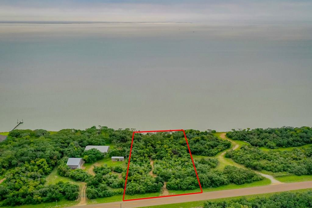 AMAZING WATERFRONT site by San Antonio Bay very close to the National Wildlife Refuge & whooping cranes winter home! A perfect location for NATURE and tranquility in mind for you to build your dream home! Easy commute from Rockport or Victoria with majestic views of the bay and high elevation. One of the best fishing spots you can wish for! Almost 2 acres and with your own private beach! The wooded live oak-redbay pathways with gorgeous under-story ecosystem hosting thriving wildlife including hummingbirds, butterflies and song birds leads you to amazing sunrises! You will fall in love with this land! Please DO NOT ENTER the property without permission & ALL buyers must be accompanied by a Texas Real Estate Agent.