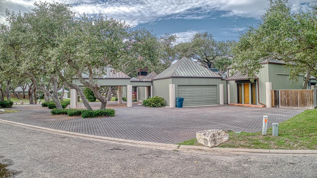 Exquisite waterfront home in Rockport's sought after Harbor Oaks subdivision. Meticulously renovated and expanded in 2014. Beautiful eat in chefs kitchen featuring granite counter tops, oversized island and stainless appliances Secluded master wing with 2 master suites and 2 luxurious baths. Outdoor living at is finest w/10,000 sq ft of deck, heated pool, outside dining area and pavilion, multiple living spaces, boat dock, air conditioned tackle room, fish cleaning stand, hydraulic boat lift.