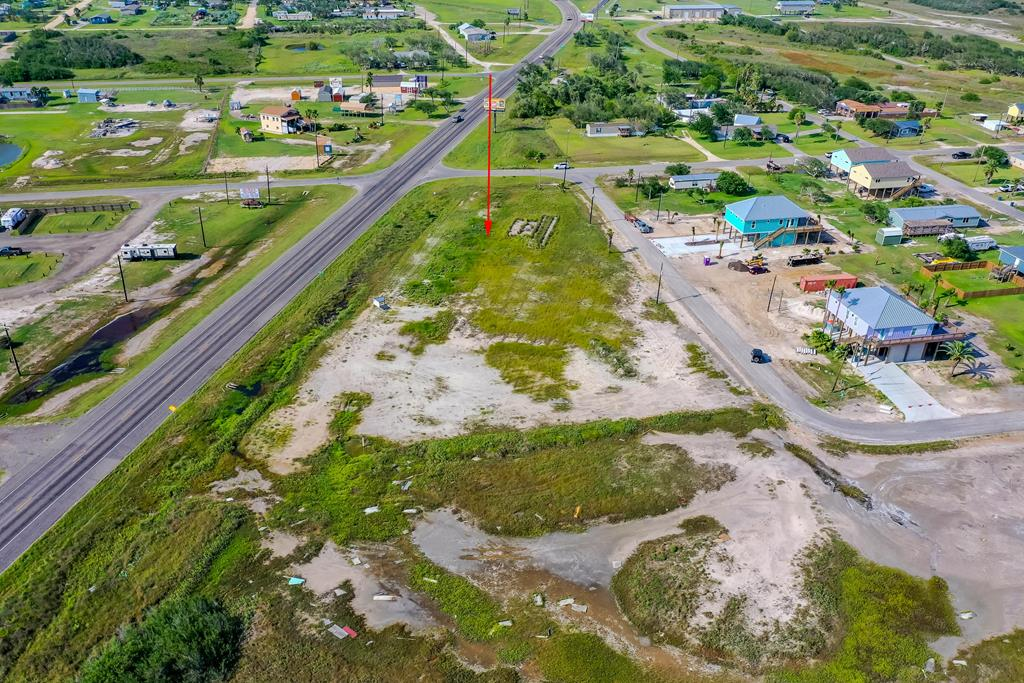 Great location to build your dream home, in desirable south of downtown Rockport, few blocks from Aransas Bay with possible water view with a 2 story house. Lot 6 approximated location on mid block on Fuqua & 10th, lot 50x110 ft approximately. Septic required, electric and city water available with tap fees, buyers to verify with city of Rockport. Other lots for sale.