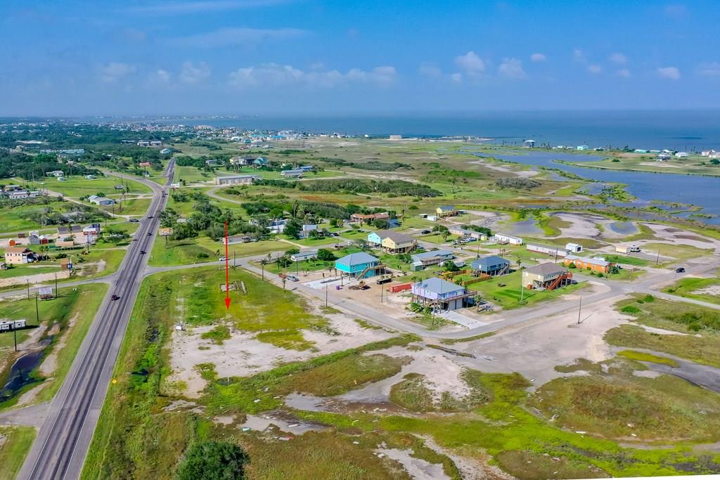 Great location to build your dream home, in desirable south of downtown Rockport, few blocks from Aransas Bay with possible water view with a 2 story house. Lot 6 approximated location on mid block on Fuqua & 10th, lot 50x110 ft approximately. Septic required, electric and city water available with tap fees, buyers to verify with city of Rockport. Other lots for sale, ask agent.