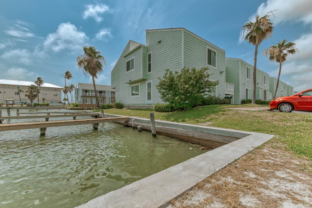 Gorgeous upstairs condo with fabulous canal views! An exceptionally renovated condo in sophisticated coastal colors. Tile flooring, soaring ceilings and crisp white paint. You'll never want to leave your Rockport Retreat!