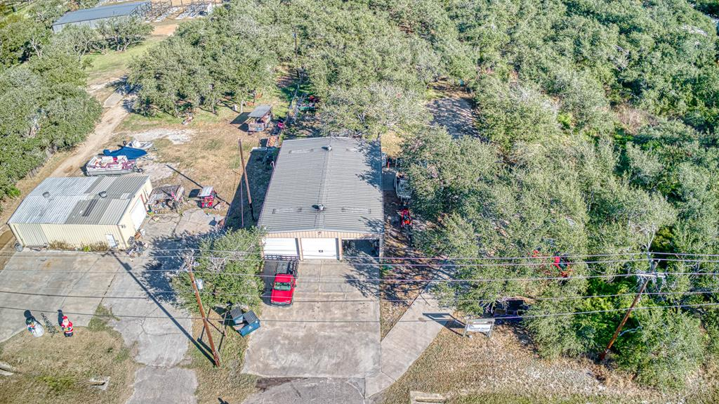 2400 Square foot warehouse with two offices and full bathroom! Located on over 1 acre, commercial zoning and lots of concrete parking. So many uses for this light industrial building, storage, wood working shop, welding shop! Lots of parking, could be used as a small R/V park or R/V storage. Imagine the possibilities!