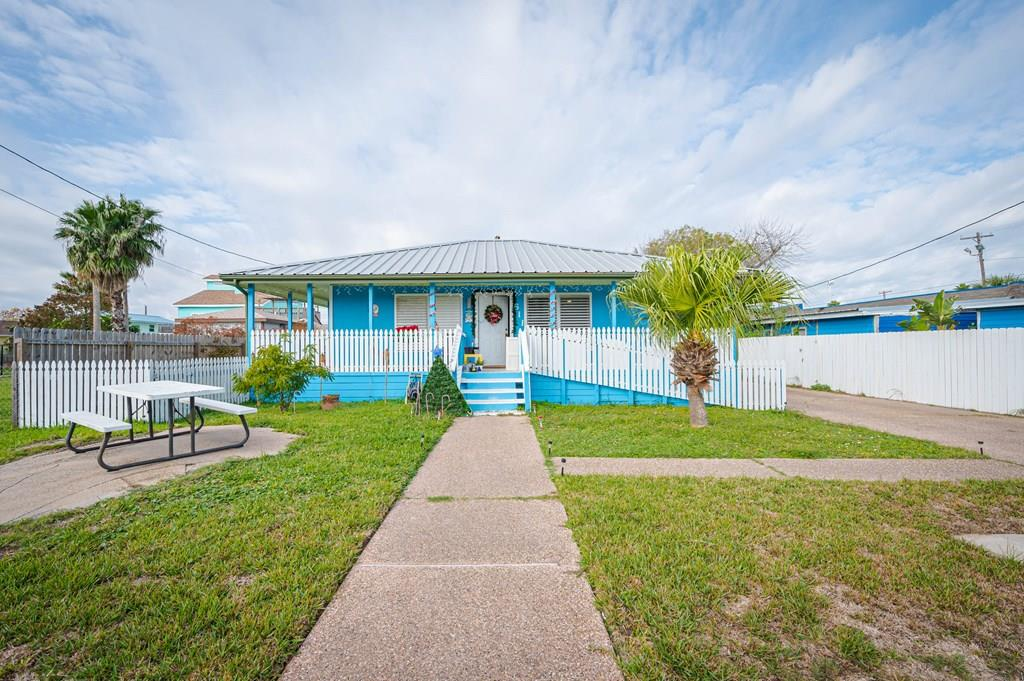 Location... location... this downtown beach cottage a block from Aransas Bay that boasts year round wade fishing and bird watching, you'll love the soft breezes at this coastal location in the heart of town, with covered front porch is the perfect spot for cup coffee watching sunrise or lazy Summer afternoon fish tales and cold tea sipping in your back deck patio. Don't forget to wave to the visitors passing by!... A cozy bedroom is perfect to catch a few winks before you head out to fish....have a guest visiting? The large second room makes the perfect spot for an over flow or owner's suite. This could make for a perfect rental potential and some love can become your Rockport Retreat. There's room for car and boat parking on the side detached garage, bring down your Rod and reel and start making memories at this adorable South Rockport Cottage!