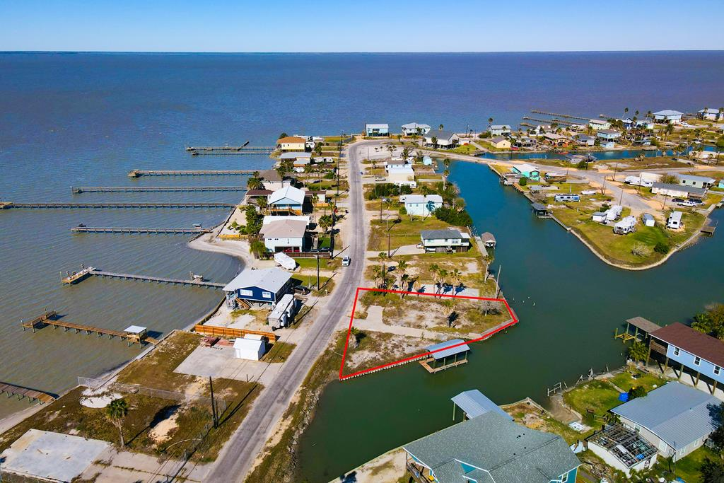 !!!COVERED BOAT DOCK & BOAT RAMP!!! Unbelievable COPANO BAY views and canal front living at this oversized lot in desirable Copano Cove. Located on the bend this great lot is the best of both worlds having great views and canal front land with a boat ramp and COVERED BOAT DOCK. The house has been fully taken down so the septic system is still in place! Bring your dreams and your house plans and start building your Rockport Retreat. Let the breeze blow and carry your worries away!