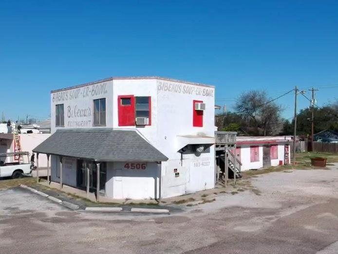 Great location! Industrial area with super potential. This building was formerly a Corpus landmark (Bibeaus Soup Er Bowl). The building has been gutted inside and ready for a makeover. Has apartment upstairs (1200 sq ft) that could easily be brought back to life. Corner lot has easy access for a new business. Lot is over 24,000 sq. ft. Endless possibilities for new owners!