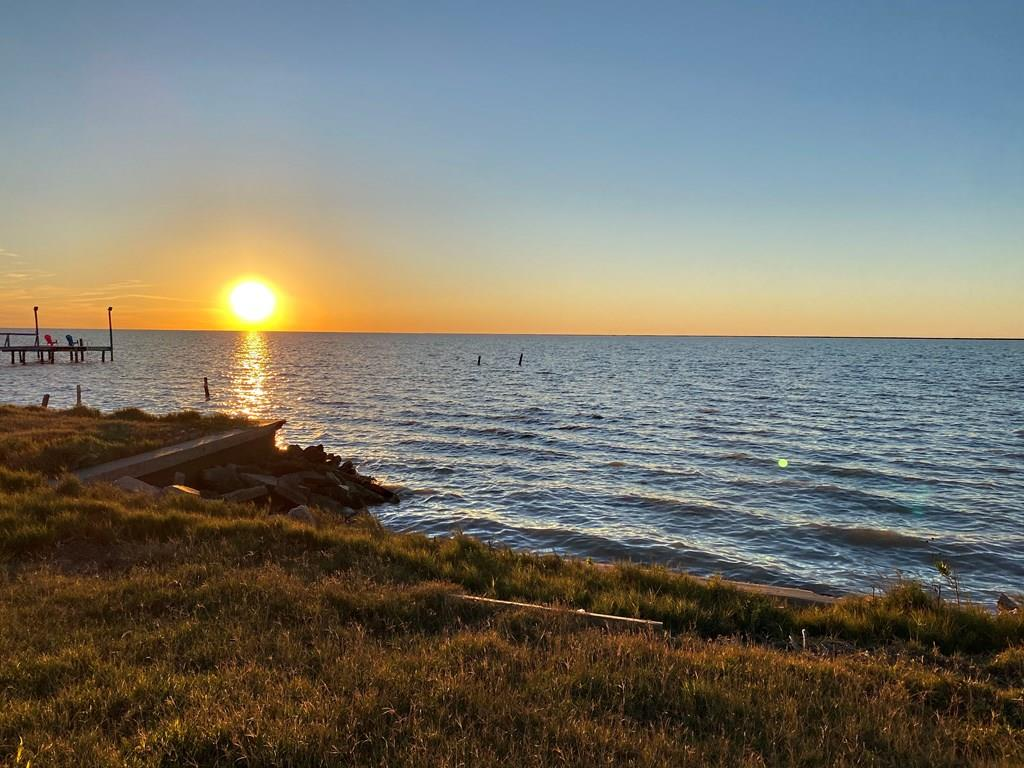 Call your builder! Don't miss out on this waterfront lot on beautiful Copano Bay. This large, cleared lot is ready for your dream home or beach getaway. Enjoy fishing, wildlife, and breathtaking sunsets in your own backyard. Holiday Beach HOA provides access to two boat ramps, a clubhouse, a private pier, and swimming pool for a small annual fee. For more information about this neighborhood, visit https://holidaybeachtx.org/. Adjacent lots also available: Lot 11, MLS# 134531 Lot 12, MLS# 134533