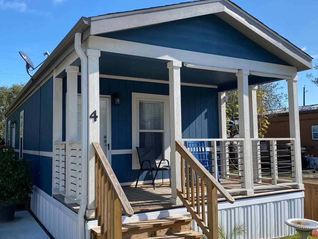 Adorable beach getaway only a short stroll to the Bay! Built in 2019, this cute cottage has everything you need for a weekender or to live the simple life. Located in peaceful Goose Island at Lamar, but only a short drive to shopping, fishing, or the Rockport's blue wave beach. There is a large paved driveway to park your boat and a nice sized fenced-in yard perfect for your kids or fur babies. The ramp provides easy access from the drive. All public utilities and many upgrades found throughout the home including, gutters, above standard insulation, and roof. Enjoy your morning coffee on the adorable front porch while watching the local wildlife. The open concept kitchen has loads of cabinets and counter space, add a couple of bar stools to the breakfast bar for additional seating. Vinyl floors throughout for easy cleaning. Kitchen appliances, washer, dryer, and storage building convey.