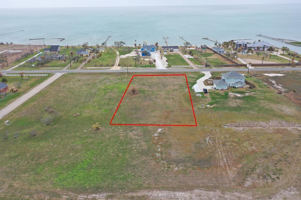 If you want a perfect spot to build your new dream view, this one-acre tract with water views is the one!! Flat and cleared land with city water available. Imagine sitting watching the waterbirds and wildlife from your front deck or off the back porch. Plenty of room for your home, workshop and pool with lots of room to spare. 1,800 sf home minimum per HOA. Don't miss out on this property!