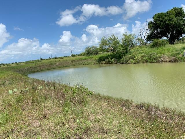 Canal front lot, flat and easy to build on. Quite cul de sac in Copano Cove. Wildlife and breezes is what this area offers. Quick access to Copano Bay & awesome fishing! Road is paved and lot is large for a custom built home.