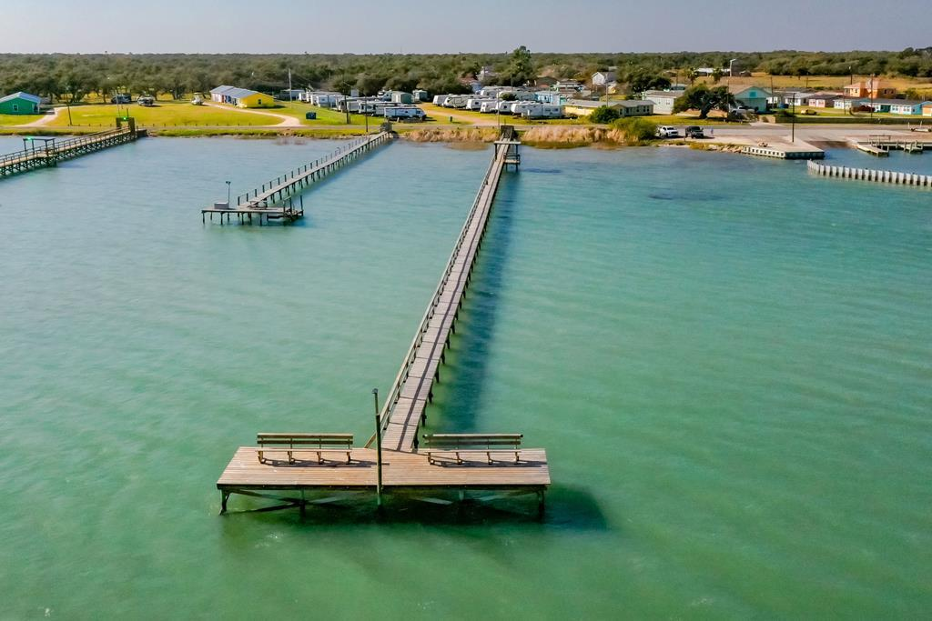 WATERFRONT RV PARK RARE OPPORTUNITY! This well-established, fully operational RV park located in Lamar, Tx, off Lamar Beach Road with 135 feet of waterfrontage. Featuring 1.703 Acres. Just steps to the public boat ramp. Amenities of park include: 500 Ft. Private Fishing Pier with cleaning station, large swimming pool & common area, Laundry room with washer/dryers and public bathroom. Quiet & tranquil area in the Lamar Peninsula, just walking distance to Goose Island State Park overlooking St Charles Bay. Featuring 30 RV hook ups. All RV spaces have 30/50 amp electricity, water & waste. This is a low-maintenance, income producing investment property with abundant value-add opportunities! Room for more units or cabins. Possibilities are endless!