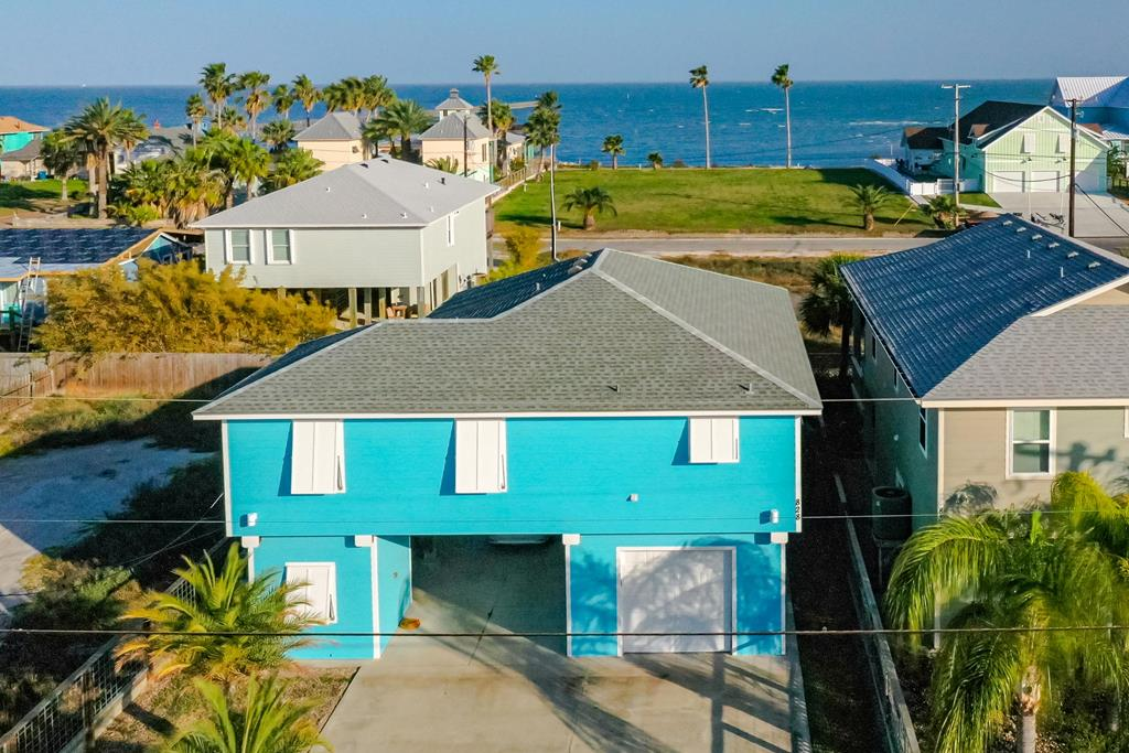 Fantastic location in South Rockport with current bay views and close to all the fun Downtown amenities. As you roll into Rockport and let the breeze sweep your worries away. Just a short walk to the community pier, boat ramp, beach, and great fishing! South Rockport is one of the best places to be in Rockport. Take your golf cart and spend time shopping, eating and drinking up and down main street. The carport and garage with storage area are a great space for guest parking and toy storage. There's a beautiful downstairs gathering area, too! The large open porch upstairs will take your breath away as you sit and enjoy the beauty of Aransas Bay! The expansive living and kitchen area are great hosting a group. The master bedroom is private and has lots of light with its expansive windows. Two guest bedrooms an full bathroom are off the living are and down a short hall. There's also a large hall storage area. The lifestyle is perfect for relaxing and enjoying life!