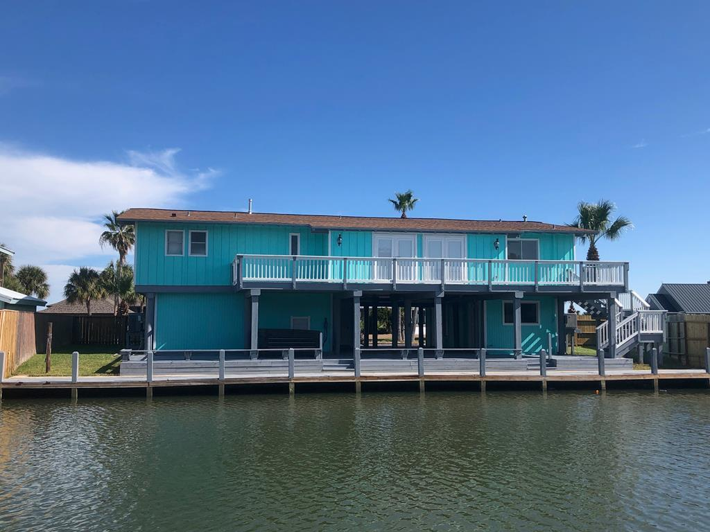 Amazing transformation! Once a simple home on Key Allegro and now a gorgeous Island Diamond. Redone from top to bottom. This 4/3/2 has stunning bay views and sits on extra long lot with 92' dock. Upstairs you'll step into the open floor plan with 3 bdrms, 2 full baths and multi purpose room that overlooks the bayside. Gorgeous pendant lighting over the breakfast bar and just a touch of gold on the backsplash are just a few designer touches this home offers. Easy access with front and back stairs in addition to the inside elevator. You will never run out of entertainment space with your huge front and back decks, covered downstairs breezeway and an additional bedroom and bath downstairs along with a tack room, storage and oversized garage. Not to mention the huge circle drive and abundance of parking. This is a must see and is being sold as a turn key property - Fully Furnished! Have I mentioned it is also Smart Home ready with Smart fridge and TV?!