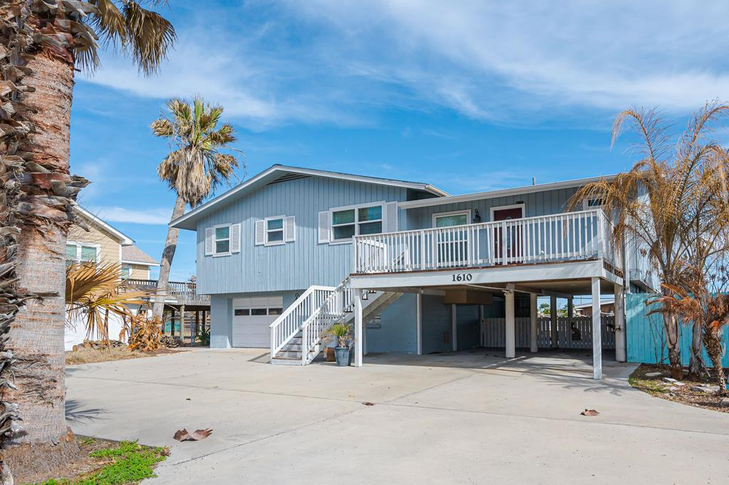 Location, location, location! Updated 4/3/2 with sweeping water views and only steps to the best fishing on the Texas coast. This home boasts exceptional outdoor living space with upper and lower decks and an outdoor palapa with a tiki bar. The pool and spa will offer fun all day, and the fire pit with seating area will be a place for friends to gather at night. The carport & circular driveway offer plenty of room for a boat, RV, or up to 6 cars. Parking is going to be important because this home boasts some of the best views of Rockport's fireworks! There is also an enclosed 2 car garage to store your toys! Downstairs has a separate entrance with a 2/1 guest suite that opens onto the pool. Upstairs has an open floor plan with breakfast bar, dining area, a living area plus a 2nd gaming/living area with gorgeous bay views. Updated kitchen and bathrooms. Master bedroom overlooks the bay. A quick golf cart ride will get you to Rockport's best shopping and dining spots. Come see!