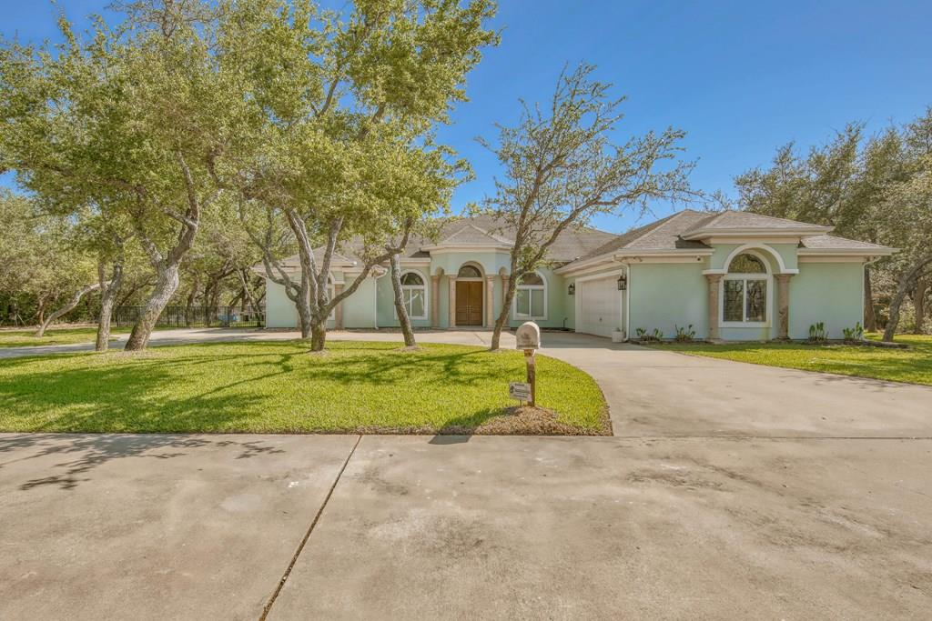 Situated on the pristine Rockport Country Club golf course & on a very private cul-de-sac w a green belt in front & on one side is this estate style home. Beautiful Cantera columns grace the front of the home w/ a backdrop of crisp coastal blue stucco. Ample parking & a circular drive add to its amenities. Once inside the soaring ceilings create an open & airy feel along w the panoramic view of the course. Icynene insulation creates an energy efficient home, impact windows & climate controlled attic are just a few the thoughtful features. An expansive eating bar, ample granite counters & open living are the perfect setting to host a crowd for an elaborate meal prepared in the island kitchen complete w stainless steel appliances, glass tile backsplash & custom cabinets. Trophy/Media room will be the setting for fun movie nights & displays.An expansive master bedroom gently glides into a resort style bathroom w walk thru shower&jet tub. More information available