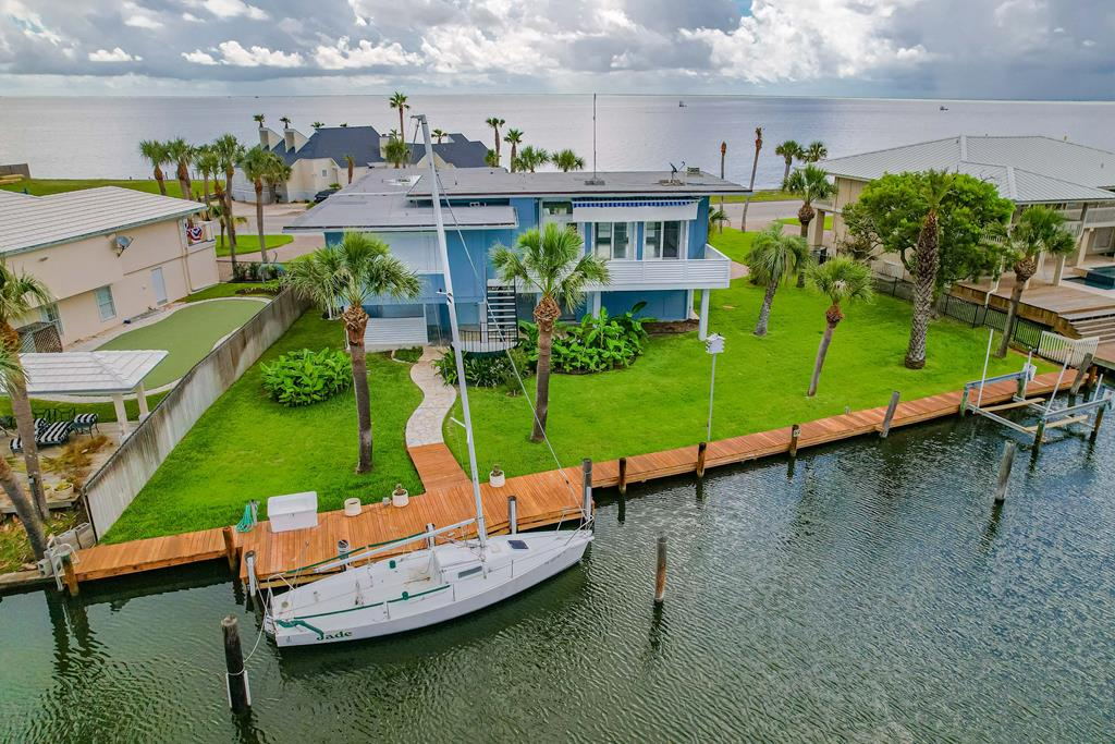 Bay Views & Canal Front! Extraordinary location in Key Allegro with an expansive back yard and waterfrontage. 1901 Bay Shore is stylish and DECKadent. Boasting East AND West decks that are generous and delightful in size. Soaring glass doors and windows invite the outside in and once inside the filtered sunlight opens up the living area. A chef inspired kitchen will be all that you need to entertain a crowd. Gas stove, gas AND electric ovens, ample counters and stainless steel appliances. Three bedrooms and two full bathrooms upstairs are nice in size and have water views, the master bedroom boasting a bay view window. Downstairs your overflow of visitors will be spoiled with access to canal fishing, boat lift and waterfront access. One bedroom and a bathroom plus workshop are all located on the ground floor. Engineered concrete & Steel construction and lovingly maintained, 1901 Bay Shore is exceptional and unique with a location that's rare to find.