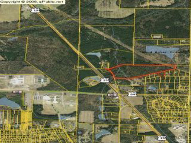 52.35+/- Acres total 50.42+/-Acres on Patterson Still Road and 1.93+/- Acres on Brentwood Drive in a great location and ideally suited for future development. Water available on Hall Road. Access from Brentwood Drive on on Patterson Still. Good Timber on Tract.