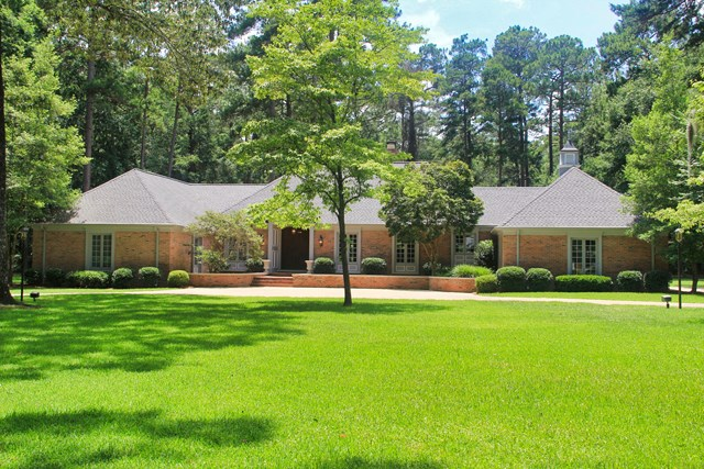 You must see this beautifully custom finished home in one of Thomasville's finest neighborhoods. It features 4 bedrooms and 5 full bathrooms with abundant space for entertaining family and friends including a gourmet kitchen with prep & eating islands, cabinets galore, finest appliances, fireplace and reclaimed pine floors. Gathering spaces also include fireplaces in each of the family, dining, and game rooms plus patio. No detail was forgotten in the oversized game room with built-in beverage station, custom cabinetry, wired media center, pool table and foosball table. Laundry room is spacious enough for exercise equipment or mudroom for kids' lockers. The master suite features his and hers bathrooms and closets, study/office or nursery and oversized bedroom area. Mature landscaping is meticulously maintained on 3.02 acre grounds including a conditioned workshop building. Additional adjacent acreage is available. Call for details.