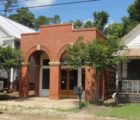 This charming historic building offers many possibilities. The original Commercial Bank building has since been renovated to accommodate a fabric store and most recently an artist studio. Unbeatable visibility on the well-traveled Metcalf Highway. Downtown Metcalf has caught the eye of preservationists and has currently been awarded a grant for improvements to Main Street and sidewalks. The building could easily be converted into living space and utilized as a studio apartment. This is your opportunity to get in on the early stages of renovations and future development of this quaint and historic community. Winner of Thomasville Landmarks Award of Merit and Georgia Historic Trust 2012 Preservation Award.