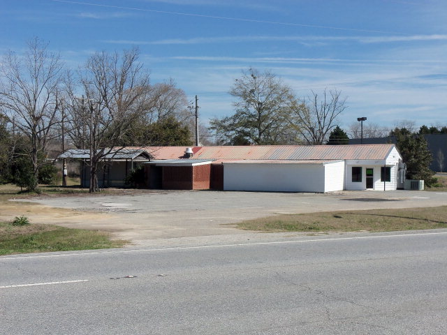 This 2.9 acres has road frontage along US Hwy 19 and McArthur Drive along the rear of property next to FREDS.  Excellent building site for a new business start.  The building former use was as an restaurant.  Little value is placed on the building.