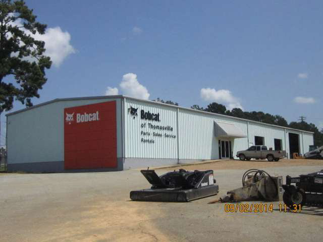 This commercial property was previously a Bobcat dealership. It fronts on US Hwy 319 North near the intersection of the US Hwy 319 bypass. Improvements include an 8000 sqft building, which includes 4142 sqft of heated and cooled office and showroom area. The second warehouse building is 1568 sqft and has four roll up doors. The third warehouse building is a single bay and is 820 sqft. here is a paved parking lot, loading dock and the entire property is high fenced. There is a second entrance off of Dillon Road.