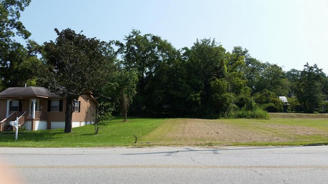 Gentle level & CLEAN lot ready for action and can be sold as part of a total package of three listed lots adjacent to each other at his location. COMMERCIAL POTENTIAL is there for this VERY HIGH visibility lot for ANY commercial venture !!!