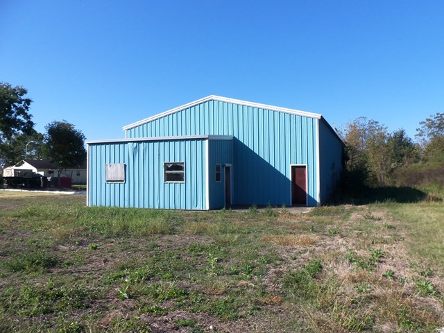 On over 3.37 acres is a finished 1,394 sq. ft. metal office building with a full kitchen and full bath that has many possibilities.  Also, a 2,360 sq. ft. metal shop building, open span, with separate 300 sq. ft. office area with a half-bath located in the front of the building and at the rear of the building is 20' x 40' fenced shelter on slab.  These buildings and land can be subdivided and sold separately.