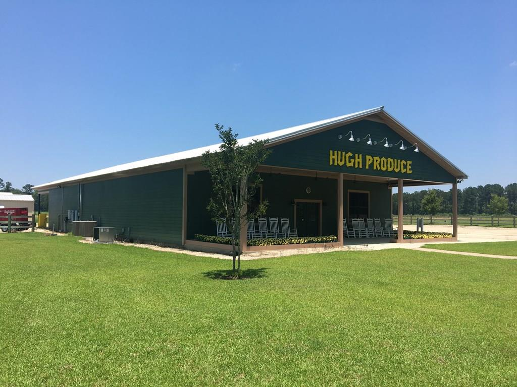 GREAT INVESTMENT TRACT OR HOME TO YOUR BUSINESS. Recently home to Hugh Produce, this property is in a prime location across from Madison Grove Subdivision and includes 43 +/- acres, two wells, and two metal buildings.  The building used for the sale of groceries and produce is approximately 4000 +/- sq. ft, includes large walk in coolers, attached garage parking, as well as furniture and shelving.  The second building is an equipment storage barn.  Owner may consider subdividing.