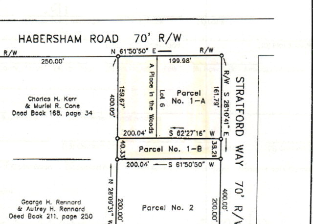 A great residential corner lot in A Place in the Woods.  City water and electricity available, must install septic tank.