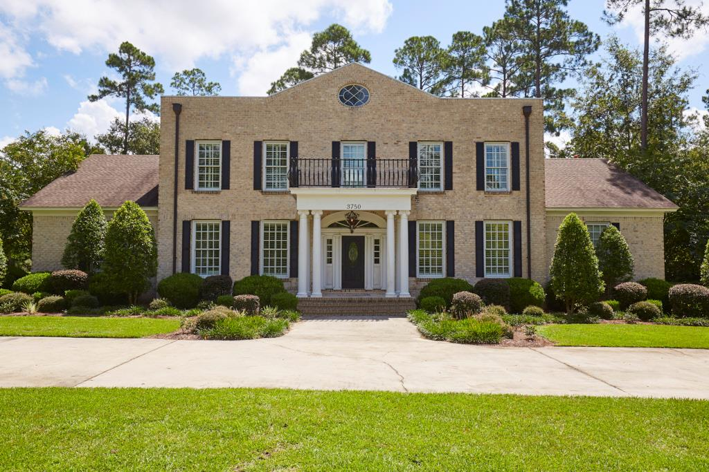 A traditional Southern beauty, this luxurious home sits near the front of Kinderlou Forest, South Georgia's premier golf course community. Enter through the manned gates and you'll find this two story home sitting on just over 2 acres. With over 5100 square feet, the interior boasts gorgeous entertaining areas, separate office with custom built ins, multiple bonus rooms, and four generous bedrooms. The large gourmet kitchen with eat in breakfast area has custom built cabinets, an oversized island, stainless appliance package, and charming brick flooring. The main level master suite overlooks the peaceful backyard and has it's own private sunroom perfect for relaxing with a good book. The master bath offers separate vanities, large soaking tub, and a spacious walk in shower. Upstairs you'll find additional bedrooms, bonus spaces and shared bathrooms. Finish your day grilling or relaxing in the beautifully landscaped courtyard enclosed with custom brick fence.
