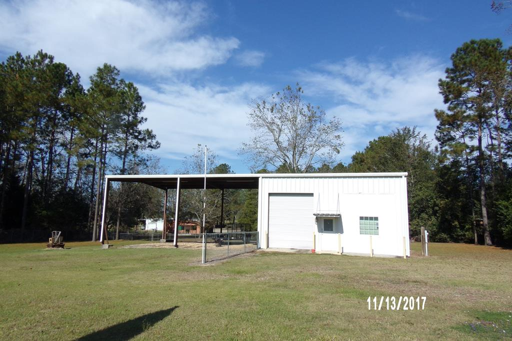 Looking for a quiet community to open a shop. This property offers over 2 acres of land and a 900sf steel building.