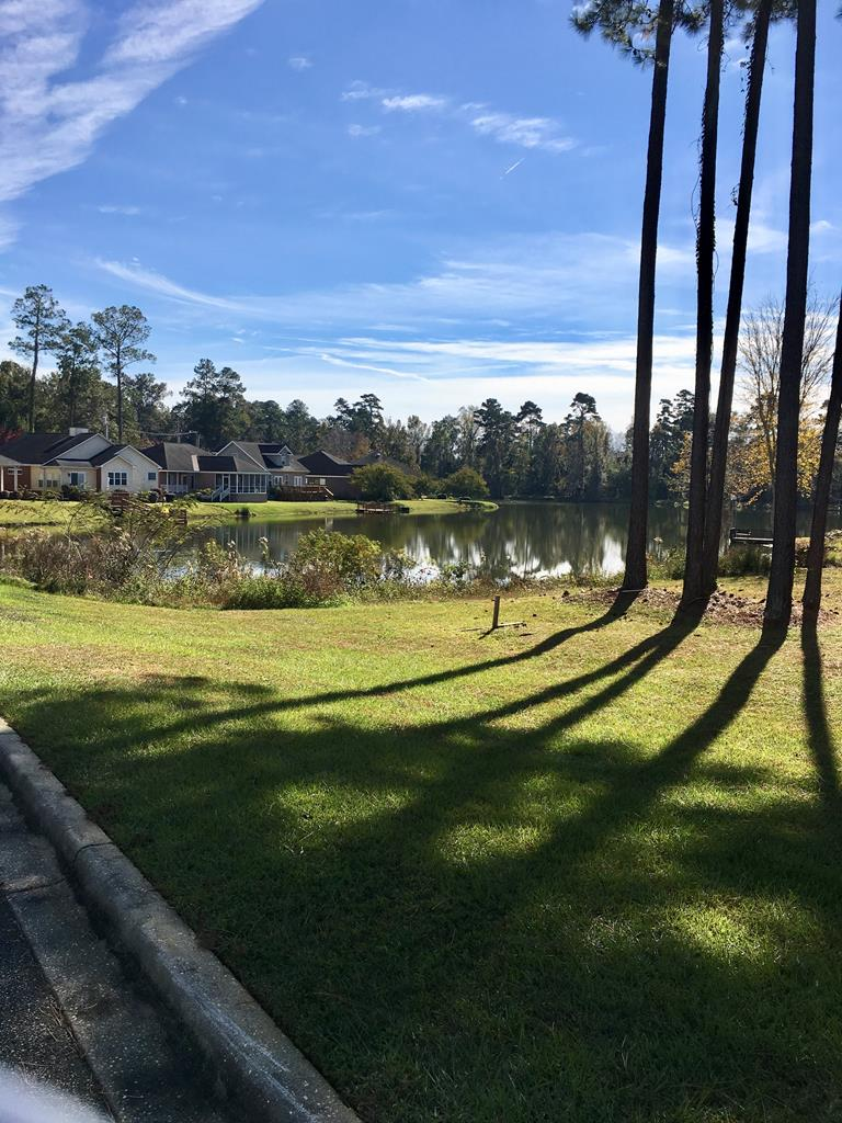Residential lot in Tall Timbers Village on Horseshoe Lake.  Build on the water, 1 mile from Publix and only pay county taxes.