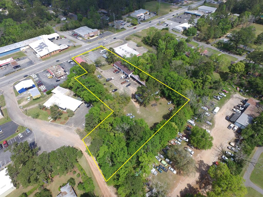 Commercial Property with 2 tenants on month to month lease bringing in $950 per month.  Multiple buildings and garages.  No environmental reports on property.  Garage and shop in back of property. This section could possibly be cut out by using the frontage on to Drive.  Concrete Block Building on side of property used as Thrift Store.  Open lot area used as small car lot.  Many uses to this property Vacant land behind ship for future building. GA DOT AADT at 14,800.  C-1 zoning has a world of possibilities.  300+/- of combined frontage on Jackson and Hadley Drive.  Auto Zone Pulls in in a lot of traffic.  US Hwy 19 is under city control in this area. 4 traffic lanes with a center turn lane makes East Jackson Street easy for business.  Build on the cleared lot area and rent out the other two parts of this property.  Good Rental History.  Priced below the Tax Value.  Estate Property.  Bring us an offer to work with!  Over 6,000 sq ft ft of building on this property.  2.54 Acres