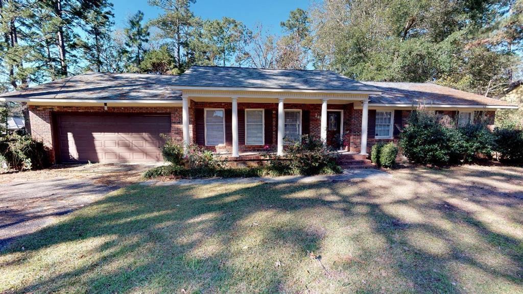 All the space you will need in this brick home in great location close to schools and shopping. This 5 bedroom/2.5 bath home is centrally located to all Thomasville has to offer and in a great family neighborhood. Close to schools, Downtown Thomasville, restaurants and hospital. Beautiful hardwood floors with large master suite and private bath. Kitchen has hard surface counter tops. Spacious walk in laundry room. Large living room with built in book cases & additional big family room. Nice back deck with large yard and 10 x 12 utility building. Call today to schedule your appointment.  https://my.matterport.com/show/?m=XwMeZonpAo7