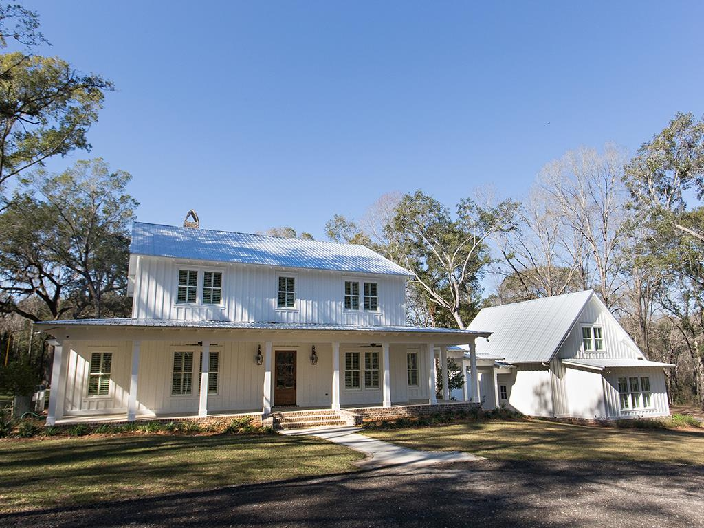 Live your best life in this beautiful farmhouse on 45 ac nestled in the heart of plantation country. A short drive to Flowers, Archbold, & shopping, enjoy the privacy & tranquility as you make memories. Built in 2018, the home offers 4 bedrooms with private baths, powder rm, study, separate dining, & open kitchen and den with gorgeous views. The master on main boasts a luxurious bathroom with his/her closets. Her closet doubles as a solid concrete safe room. Prepare meals in the gourmet kitchen where seating for 6 at the center island creates the perfect gathering place. Integrated sound system offers 4 zones, & the home intercom system keeps everyone in touch. A detached retreat with full bath & kitchenette assures privacy for your guests. Relax with delight on the covered patio with outdoor kitchen overlooking the saltwater pool & lush landscaping. A 48x40 barn/workshop & a chicken coop sit just down the hill. So many unexpected custom touches throughout. True Southern living indeed!