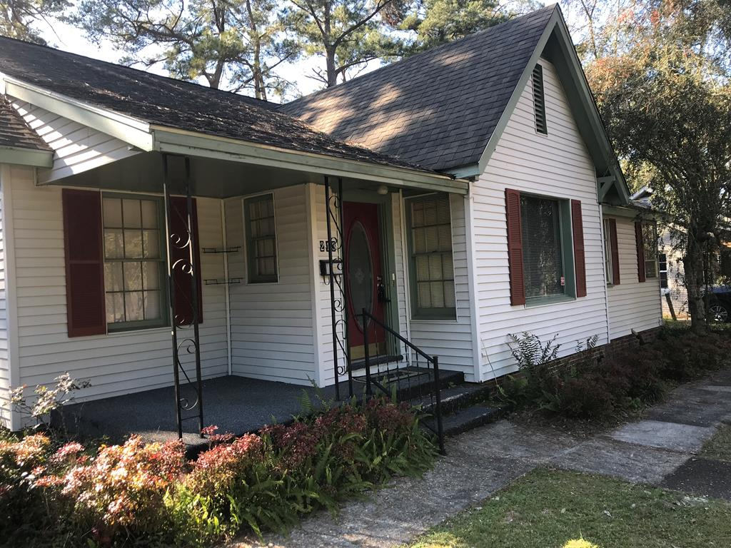 Own a piece of Thomasville History....This Charming  family home is across from MacIntyre Park and convenient to schools, shopping, and hospital. Home has 1980 sq ft floored attic space  that could be converted to additional living space for a total of 3960 sq ft. Covered patio off kitchen opens to a nice backyard with exterior brick patio and detached  2 car garage with small work shop.Home interior features, small sun room, great room with fireplace, separate formal dining room, den,additional breakfast area and 3 large bedrooms. Kitchen has great cabinet space with newer cook top. Updated and enlarged bathroom in 2009 with tiled shower.