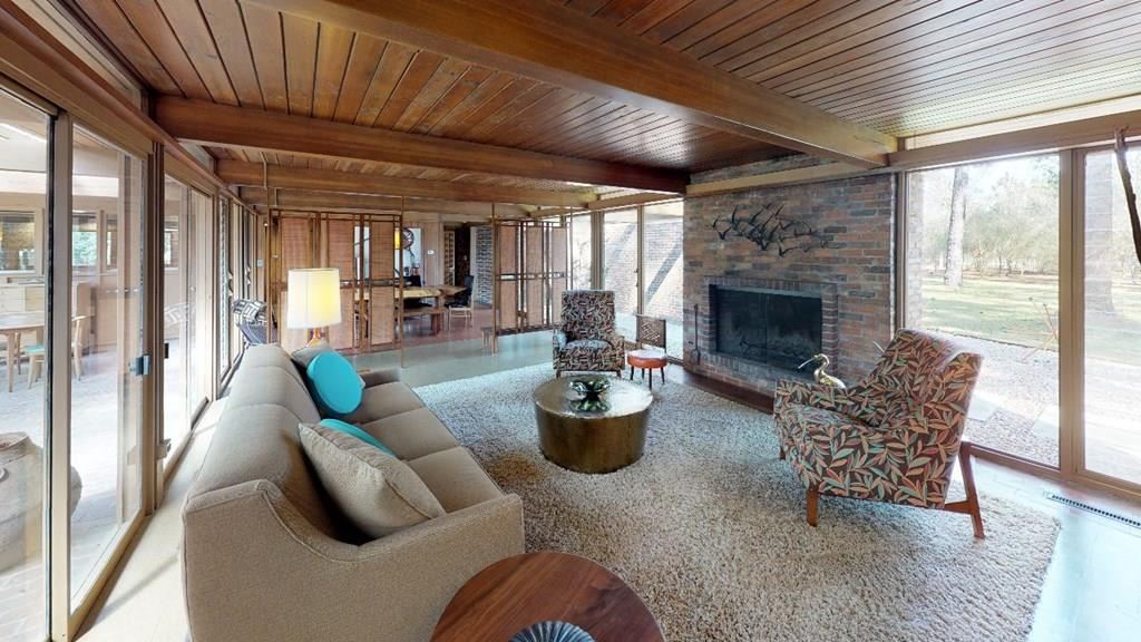 Take a step back in time to this tastefully restored mid century home. This is a meticulously maintained property, complete with furnishings and decor that compliment this unique house. Floor to ceiling windows throughout allow for ample natural lighting. Original wood ceilings and real wood paneled/exposed brick walls have been restored to their original glory. A covered patio ideally suited for entertaining allows you to enjoy the well maintained 3.71 acre grounds in peace and tranquility. Come see to appreciate this timeless masterpiece. Cut and paste the following link into your web browser and enjoy a virtual tour of this property:  https://my.matterport.com/show/?m=WUUC1BTSLLd