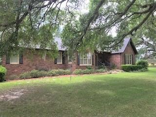 Country living minutes from town Beautiful Brick home located close to Thomasville schools and shopping . Home is situated on 2.18acre corner lot with an in ground pool . Exterior features include beautiful majestic oak tree in front yard,  large workshop with utilities,  and lean to for Campers and boats. Nice wood flooring  throughout this 3bdr/2  bath home, Separate formal dining room, wood burning fireplace with nice brick hearth, large walk-in laundry room with sink and has room for freezer. Kitchen has been completely remodeled with granite  counter tops, custom oak cabinets, beautiful  tile backsplash and top of the line stainless steel appliances. This home  also has nice sunporch, and attached pool house/ garden room.