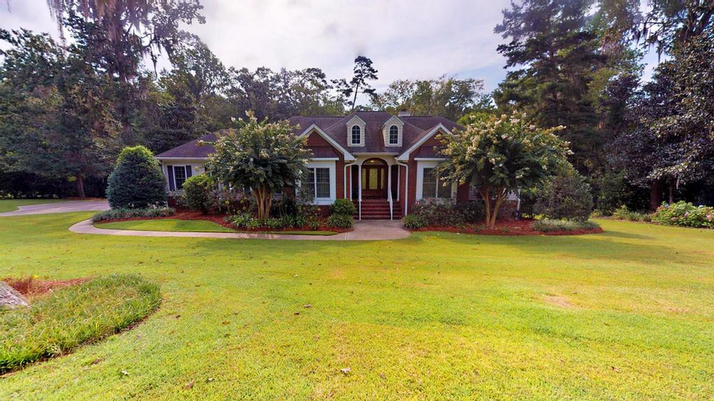 Big and Beautiful!! This home was built in 2006 and is in excellent condition. Almost 3500 sq. ft.with main floor having nice kitchen and breakfast area overlooking fireside living room,two bedrooms, 2 baths. Master suite has His and Hers walk in closets, a door going to a deck and a luxury bath w/whirlpool tub, water closet and nice shower. Formal dining room and large laundry room. A large screened porch off the living room with two decks is perfect for the family that wants outside living space...great for entertaining. Lots of crown molding and solid doors. Downstairs is a walkout basement. Family room with another fireplace (gas), another master bedroom w/bath, also a 4th bedroom and bath. Note the safe room, It is cedar lined and great for protection from any storms. Also huge storage closet is on basement level. Walk out to beautiful, covered brick patio area overlooking very private backyard (2.38 A.) Double garage,sprinkler system,invisible fence & surround sound.