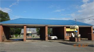 income producing commercial property.  Car wash with 3 self service bays, 1 auto service car wash and 5 self service vacuum machines.  C-2 zoning corner lot with high visibility and a high traffic area at a traffic light makes this a very attractive site for future development.