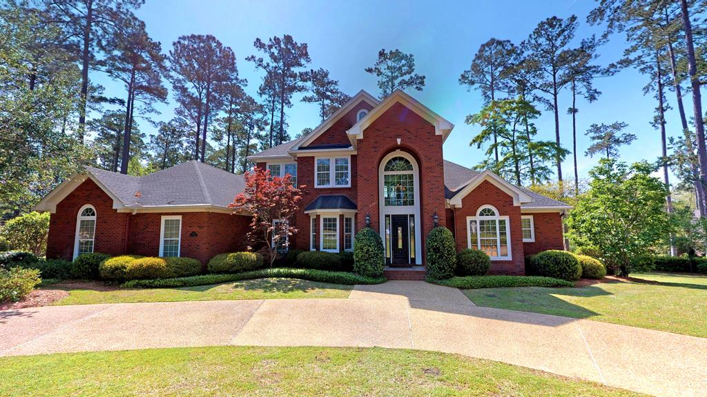 Gorgeous custom built family home located in one of Thomasvilles most desirable neighborhoods, Oak Trace. 4 BR/4.5 BA home has approx 4798 sq ft on a beautiful 1.1 acre lot.  Entry foyer has 21 ft ceilings and opens into a formal dining room, center hall and den with fireplace. Hardwood floors, crown molding, and 10 ft ceilings throughout downstairs. Open kitchen has gas cooktop, granite countertops, center island, double ovens, stainless appliances and eat-in breakfast bar that opens into a family room with lots of natural light.  Downstairs Master Suite with luxury bath that includes separate his/her closets w/ built-ins, separate shower, garden tub. Additional bedroom and bath downstairs. Upstairs is a large office/bonus room, exercise room, 2 bedrooms and 2 full baths.  Screened patio (2 levels) overlooks beautiful back yard.  Security system, sprinkler system, 3 car garage, circular aggregate driveway, parking pad, wrought iron fencing, professional/mature landscaping.