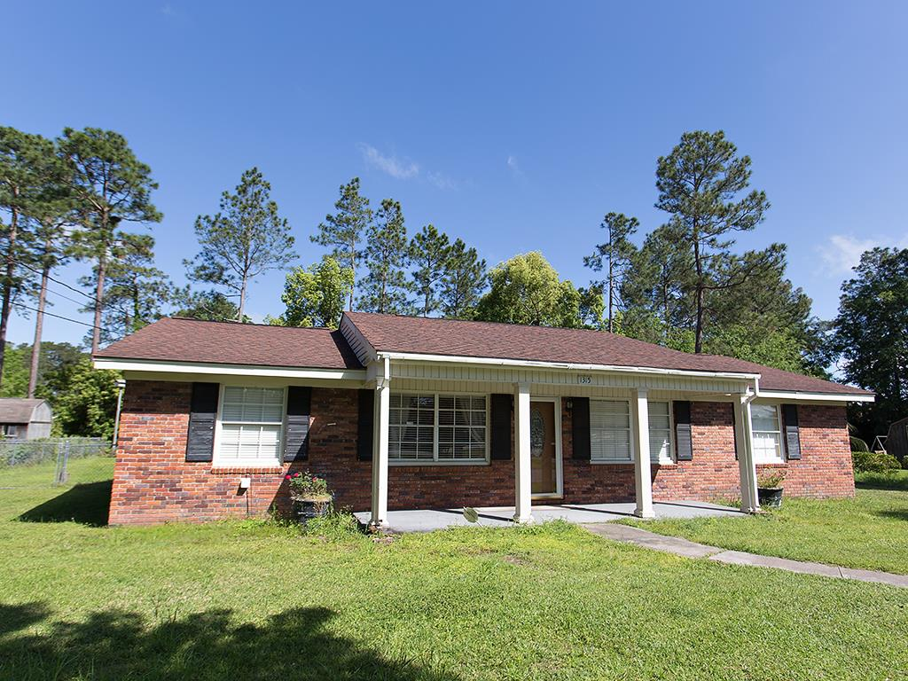 Well loved brick home conveniently located in the heart of Thomasville features 3 bedrooms and two full baths. Updated laminate flooring throughout the kitchen, living and dining rooms, and down the central hall. Bonus space off dining room could easily be finished for an office or playroom. Private backyard with pretty landscaping has a separate shed and covered parking. If you're looking for quick access to dining, shopping, parks and recreation, this home is for you!