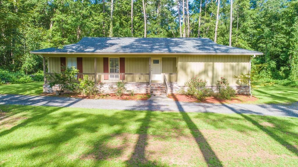 Location,location,location!This house is tucked away on a 1.36-acre lot just off of Summerhill Rd in Thomas County and is only minutes from town making it the perfect combination of cozy and convenient.This 1,964 sq. ft. house has 3 bedrooms / 2 bathrooms that feature wood flooring and ceramic tile throughout.Just inside the front door, the spacious entryway leads to the huge family room which features a fireplace with custom built ins that would be perfect for extra storage and display.The kitchen has stainless steel appliances and new custom cabinets.The kitchen is attached to a well-lit formal dining room perfect for entertaining guests.The house also has a large laundry room perfect for storage.All of the bedrooms are generously sized, and the master suite includes a walk-in tiled shower and a walk-in closet.The outside has a large backyard with a deck that is perfect for weekend barbecues and family.NEW ROOF.NEW FLOORING.HOUSE WAS MOVED TO THIS LOT IN 2014 AND MUCH OF HOUSE IS NEW