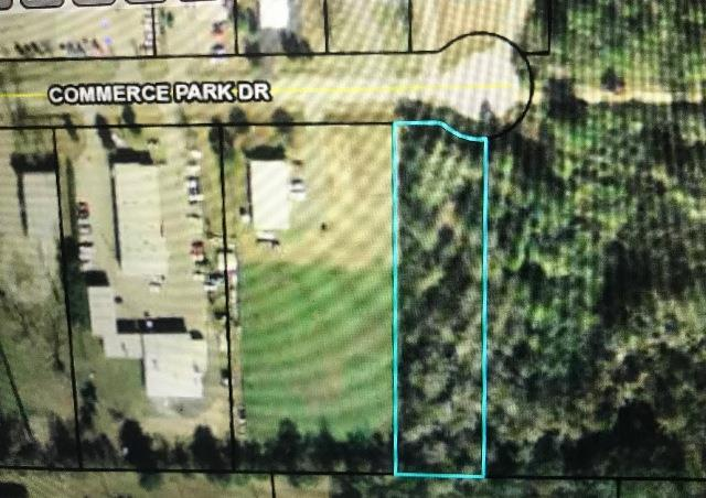 Vacant lot one block north of WalMart. This cul-de-sac street has several successful businesses and would be ideal for many uses. Convenient location and priced under tax value. 1 block off Hwy 319 North and 2 blocks from corner of Hwy 19 and Hwy 319. Seller is spouse of Ga Real Estate Agent #12189