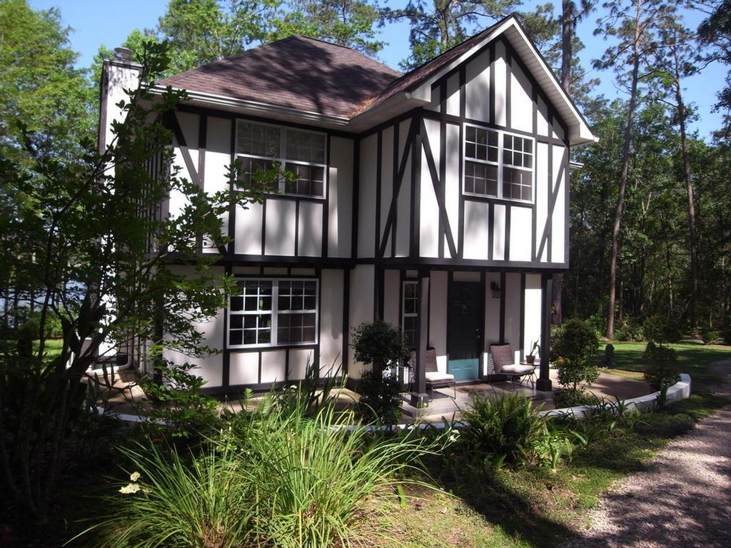 If serenity and privacy are what you're looking for, then you must see this custom built two story  home overlooking beautiful Deer Lake!  This home offers a  kitchen that is light, bright and inviting with a center island and stainless steel appliances. A large great room, guest bath and laundry room complete the first floor. Upstairs you will find another living area perfect for a home office, 2 guest bedrooms, guest bath and master suite with a balcony to enjoy your morning coffee while looking out at the lake.  Nature lovers will appreciate the over 2 acre lot that is abundant with native azaleas, viburnum & camellias. Enjoy afternoon walks around the lake or if you're a fisherman it works for you too! Don't miss out on this special and unique piece of property...it could be your little slice of heaven!