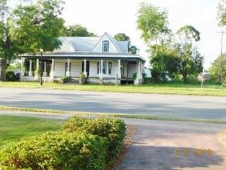 Built in the early 1900, 14' x ceilings, hardwood floors, new metal roof, new vinyl siding and windows. The owner has completed the exterior of the house, the interior is in need of renovations.  This property has the largest ROI lot in Camilla with a guest house in the back, which is rented.  The property has frontage on Broad and N Ellis St, near the Mitchell County Hospital.   This property would make a grand home or a great business location