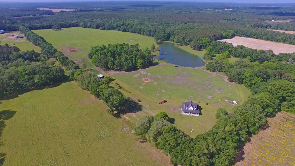 This majestic turnkey property sits on 84.83 +/- acres and is perfect for livestock,hunting,or a lab tract.Located in Thomas County,youll love this southern down-home atmosphere just a short drive to Thomasville.Drive down the scenic lane past the guest house to the custom main house with wrap around porch overlooking the pond.The first thing you notice about this house is the picture-perfect scene straight out of southern living;but that is only the beginning.Inside you will find brand new oak hardwood floors,an open and airy floor plan,3 bedrooms/2 tiled bathrooms,and views that money cant buy. Property features include a beautiful and size-able pond,moss covered live oaks,and improved pastures for grazing. It has been fence and and has mature fruit trees. (Also see MLS # 915416)