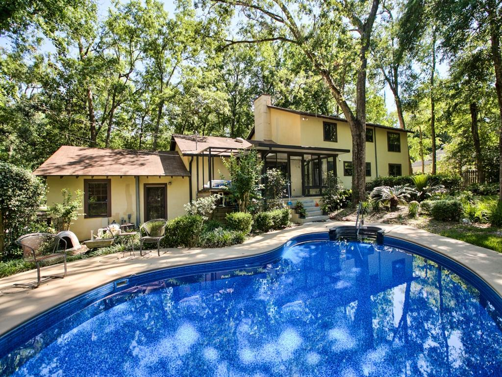 Beautiful ONE-OWNER home with pool!!  This house has all the privacy and space within the city limits.  Enjoy the large 4BR/4BA home (sitting on 2.03 acres) and the peaceful backyard with pool.  Master suite has fireplace with two large walk-in closets.